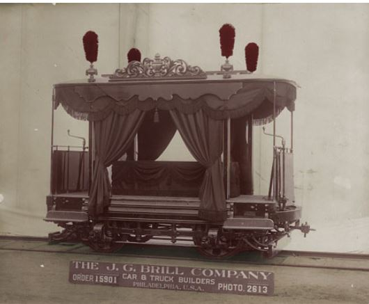 1st Class Funeral Motor Body for Guinle & Company of Bahia, Brazil (Photo #2613, Order #15901--Ordered March 16, 1907, Delivered June 15, 1907) This photo depicts an open, ornate funeral car with a platform for a casket at the center of the car, draped in black cloth. The sides of the car have heavy black drapes held open with tiebacks, and there are four black plumes on each corner of the roof. Funeral cars were not commonly used in the United States, but were frequently ordered by railroads in Latin America. http://www2.hsp.org/collections/manuscripts/brill/inventory.htm