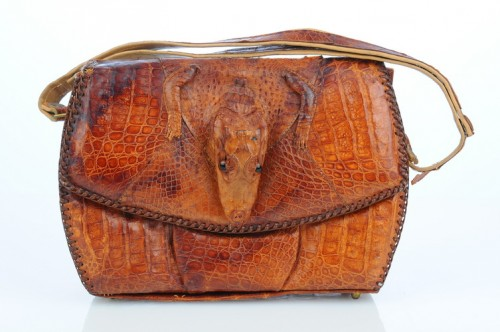 An alligator handbag of a much later date. http://www.artfire.com/ext/shop/product_view/VintageAnelia/4777103/Alligator_Handbag_with_head_feet/Bags_Purses/Handbags