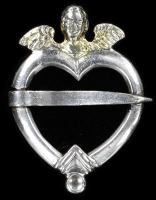 An 18th c. heart brooch http://collections.vam.ac.uk/item/O118011/ring-brooch-unknown/