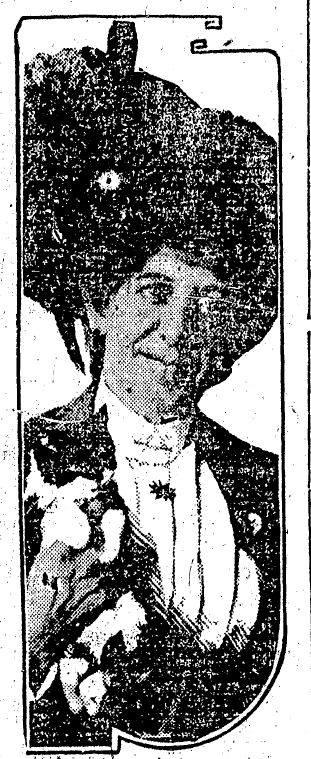 """She Once Was a Tabby: Mrs. Hattie M. Freeman Mrs. C.L. Freeman, a rich incarnated cat, holding her prize pet, """"Raffles,"""" who's still in the feline stage of existence."""