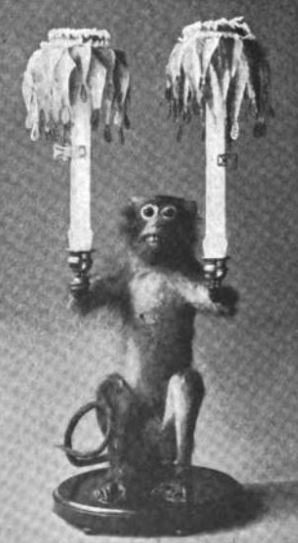 Pet monkey holding candelabra